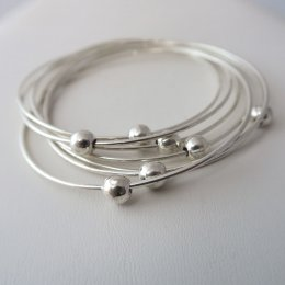 Dancing Planets Sterling Silver Bangles