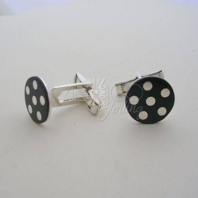 Sterling Silver Cufflinks and Black Background
