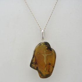 Amber Silver Pendant with Carved Figure